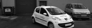 Black and white image of Edinburgh Car Services service vehicles